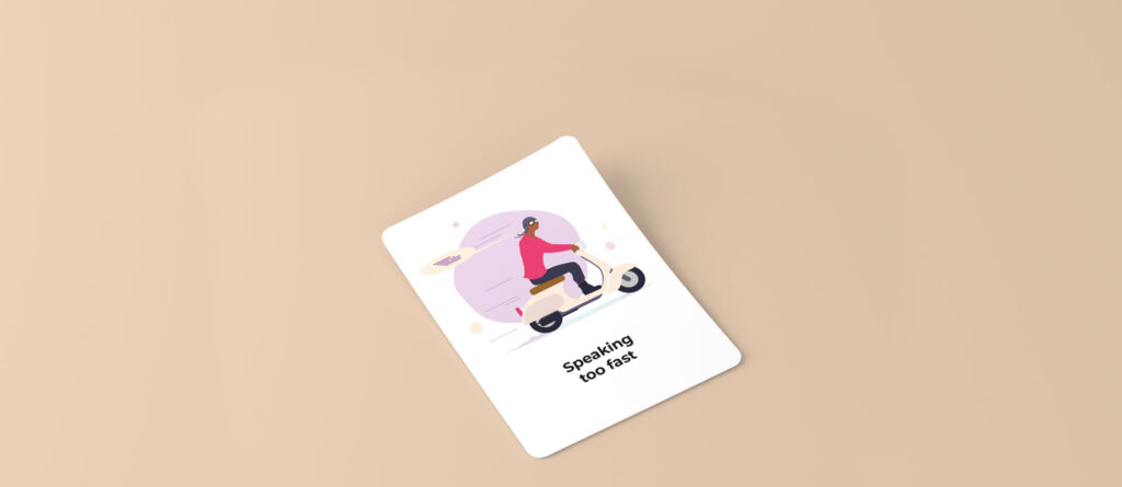 Playing card with an illustration of a man with goggles on a scooter and a speech bubble indicating he's going really fast
