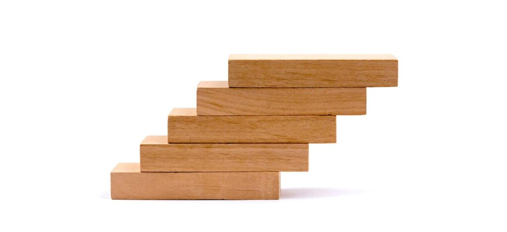 Wooden blocks piled up like stairs